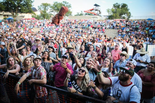Concert goers reach for a shirt during the Wild West Fest Friday, Aug. 3. 2018, at Bill Aylor Sr. Memorial RiverStage.