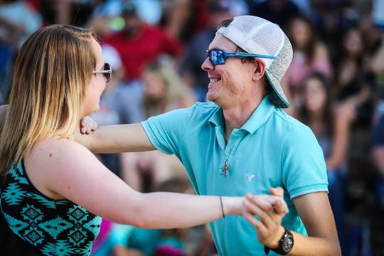 Kelsey Kemp and Ross Kelley dance during the Wild West Fest Friday, Aug. 3. 2018, at Bill Aylor Sr. Memorial RiverStage.