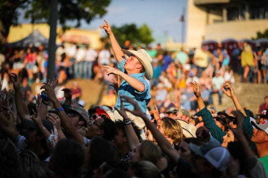 Fans cheer on the bands during the Wild West Fest Friday, Aug. 3. 2018, at Bill Aylor Sr. Memorial RiverStage.