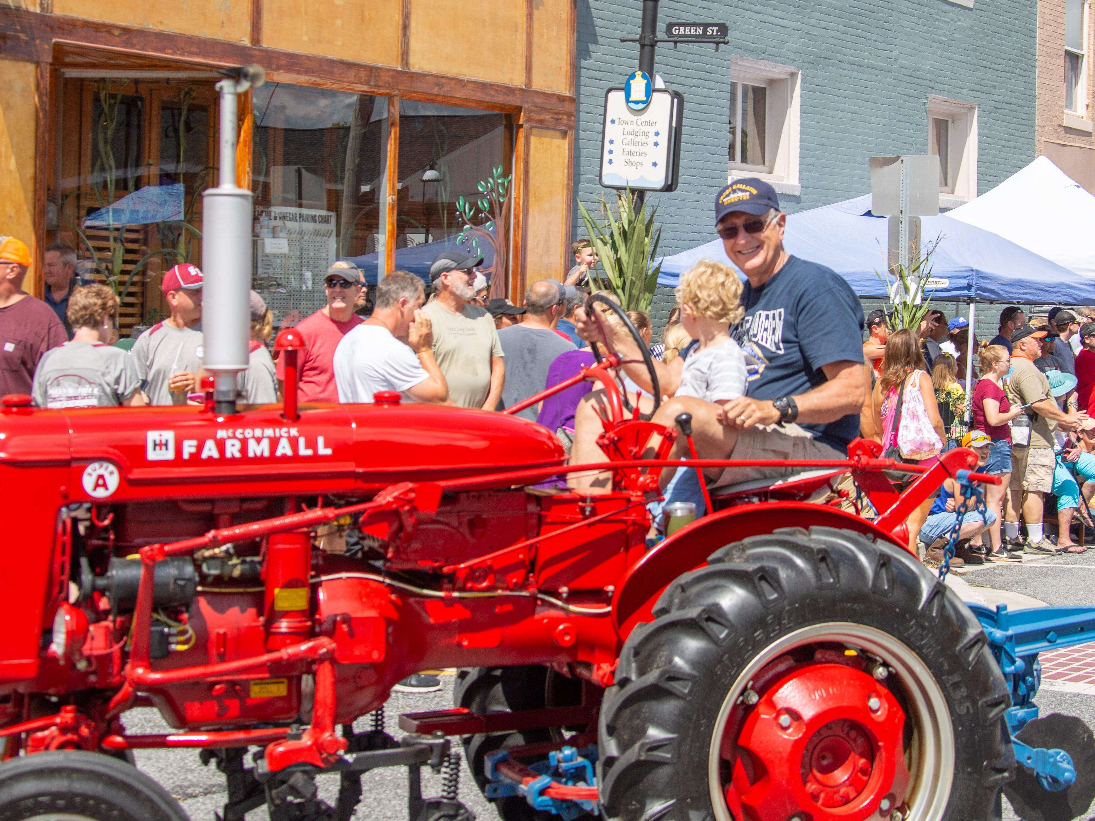 A tractor takes part in the parade at  Snow Hill's 20th Blessing of the Combines on Aug. 4.