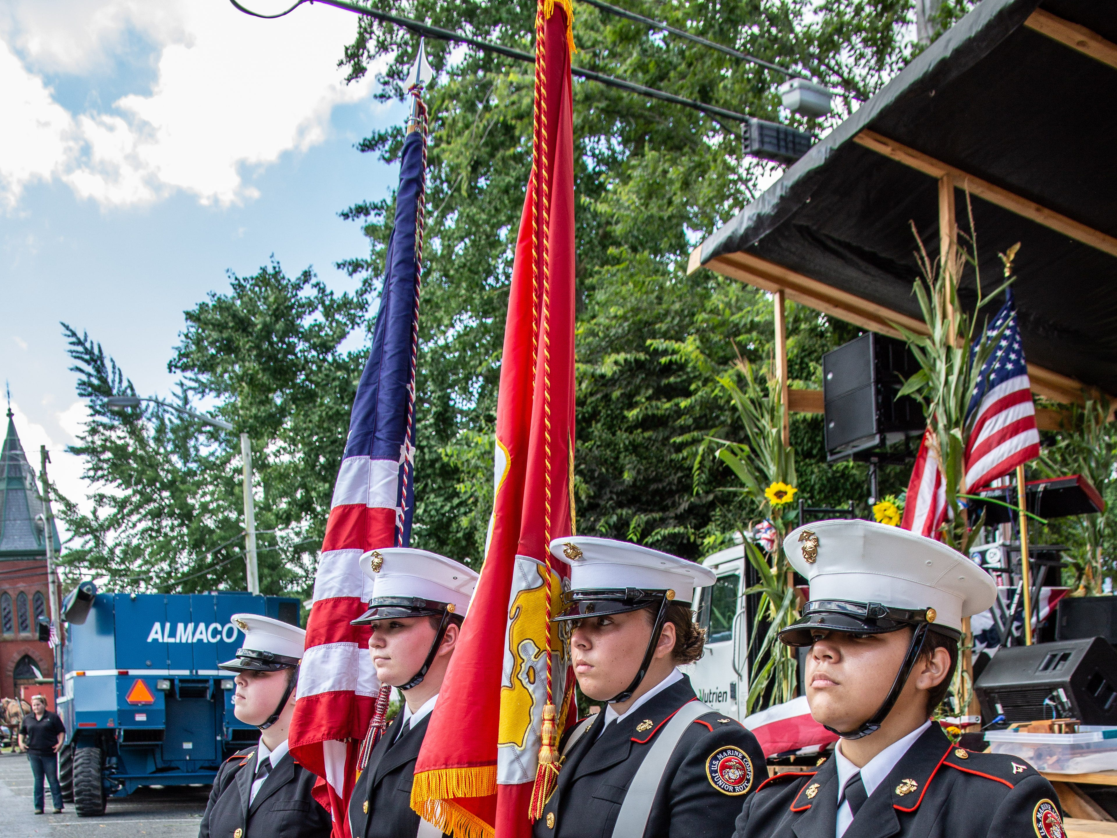 An honor guard presents the colors at Snow Hill's 20th Blessing of the Combines on Saturday.