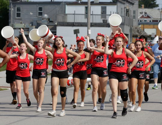 Sheboygan South's cheer squad put forth cheers during the Brat Days parade, Saturday, August 4, 2018, in Sheboygan, Wis.