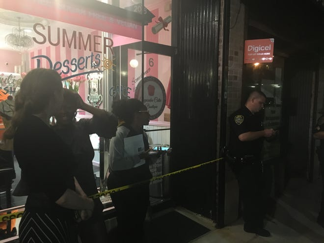 """Police were ordered by the mayor to """"wait out"""" Cupcake Cutie Boutique supporters, who refuse to leave the store, Councilman Andre Wallace said."""