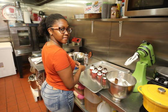 Baker/owner Miesha Stokely is pictured Saturday in her Cupcake Cutie Boutique on South Sixth Avenue in Mount Vernon.