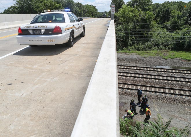 Emergency personnel work on the train tracks under Red Mill Road in Ogletown after a person was struck by an Amtrak train just before noon Saturday.