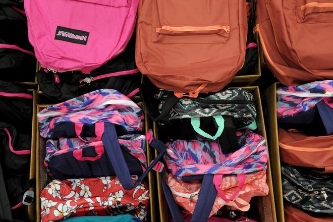 Backpacks filled with school supplies were given out Saturday, Aug. 4, 2018, at Project Back to School in the Ray Clymer Exhibit Hall at the MPEC.