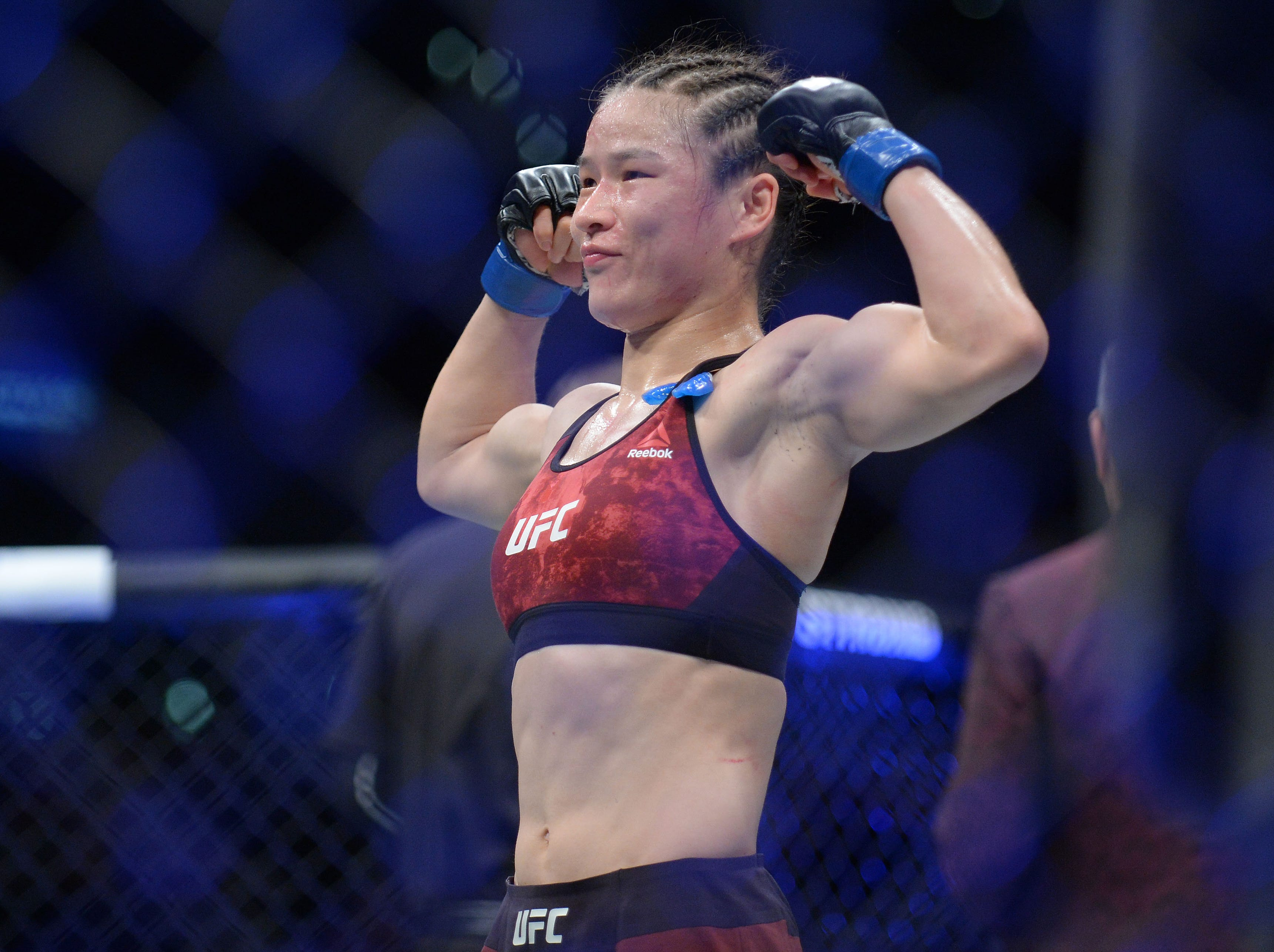 Weili Zhang reacts following her victory by decision against Danielle Taylor during UFC 227 at Staples Center.