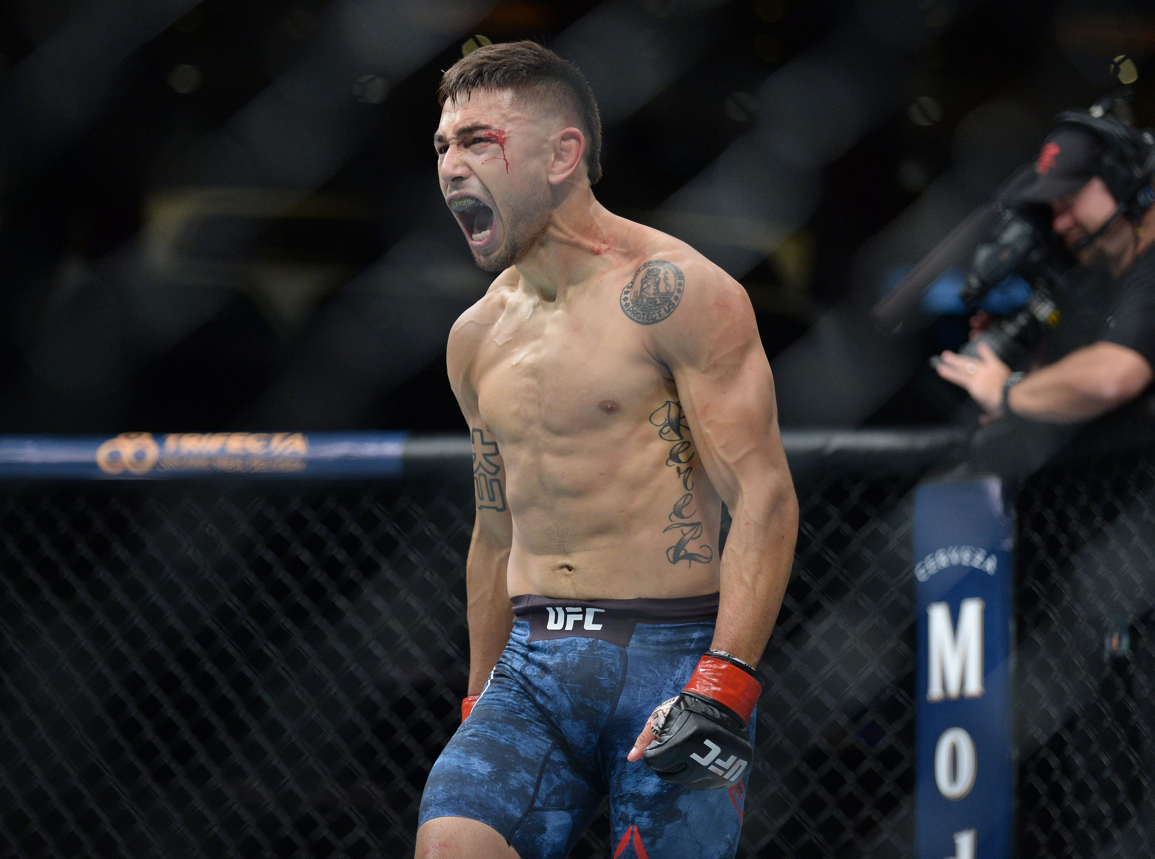 Alex Perez reacts after his knockout victory against Jose Torres during UFC 227 at Staples Center.
