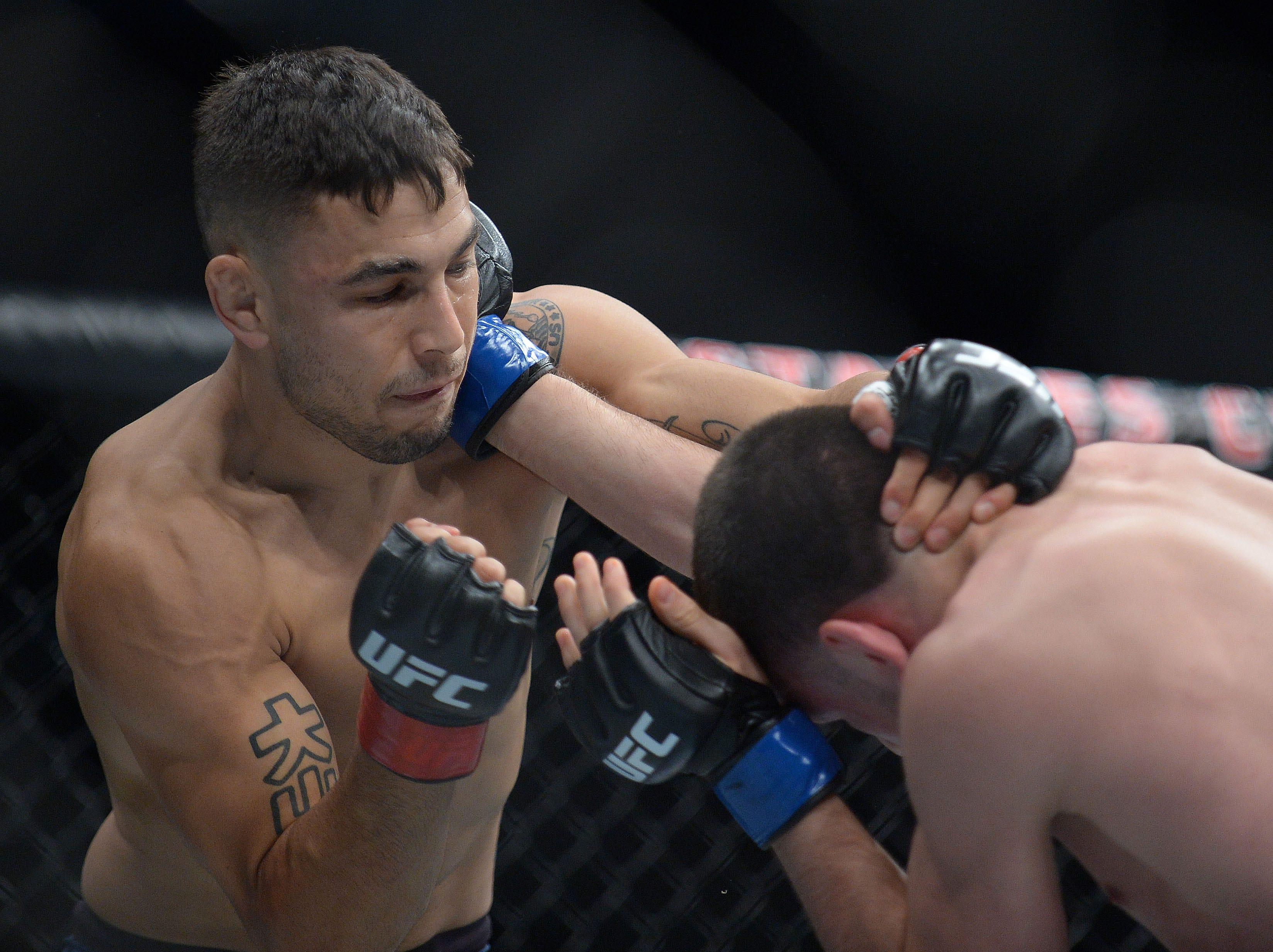 Alex Perez defends against Jose Torres during UFC 227 at Staples Center.