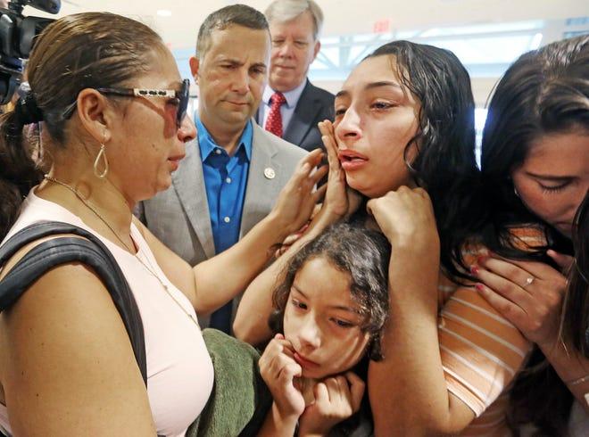 Alejandra Juarez, 39, left, says goodbye to her children, Pamela and  Estela at the Orlando International Airport on Friday, Aug. 3, 2018 in Orlando, Fla.