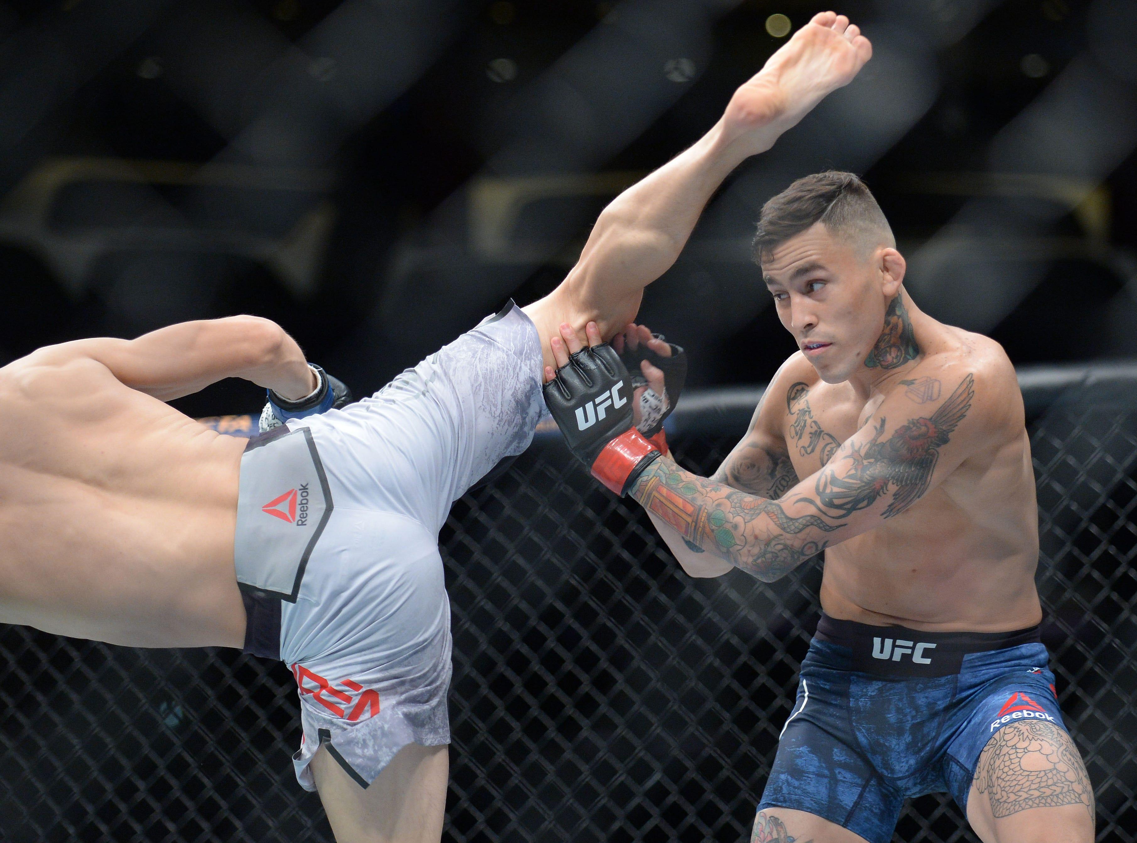 Marlon Vera defends against Wuliji Buren during UFC 227 at Staples Center.