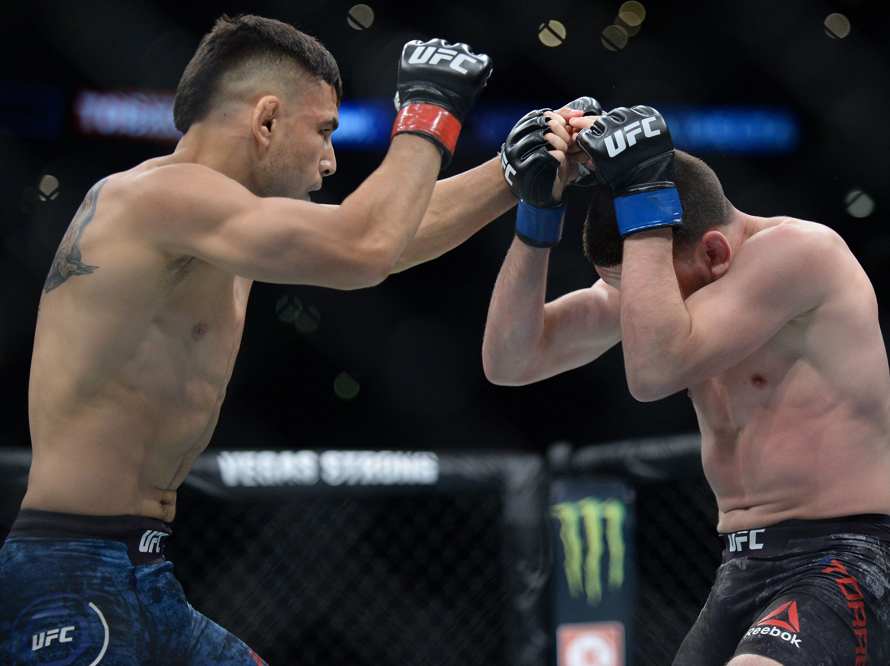 Alex Perez moves in against Jose Torres during UFC 227 at Staples Center.
