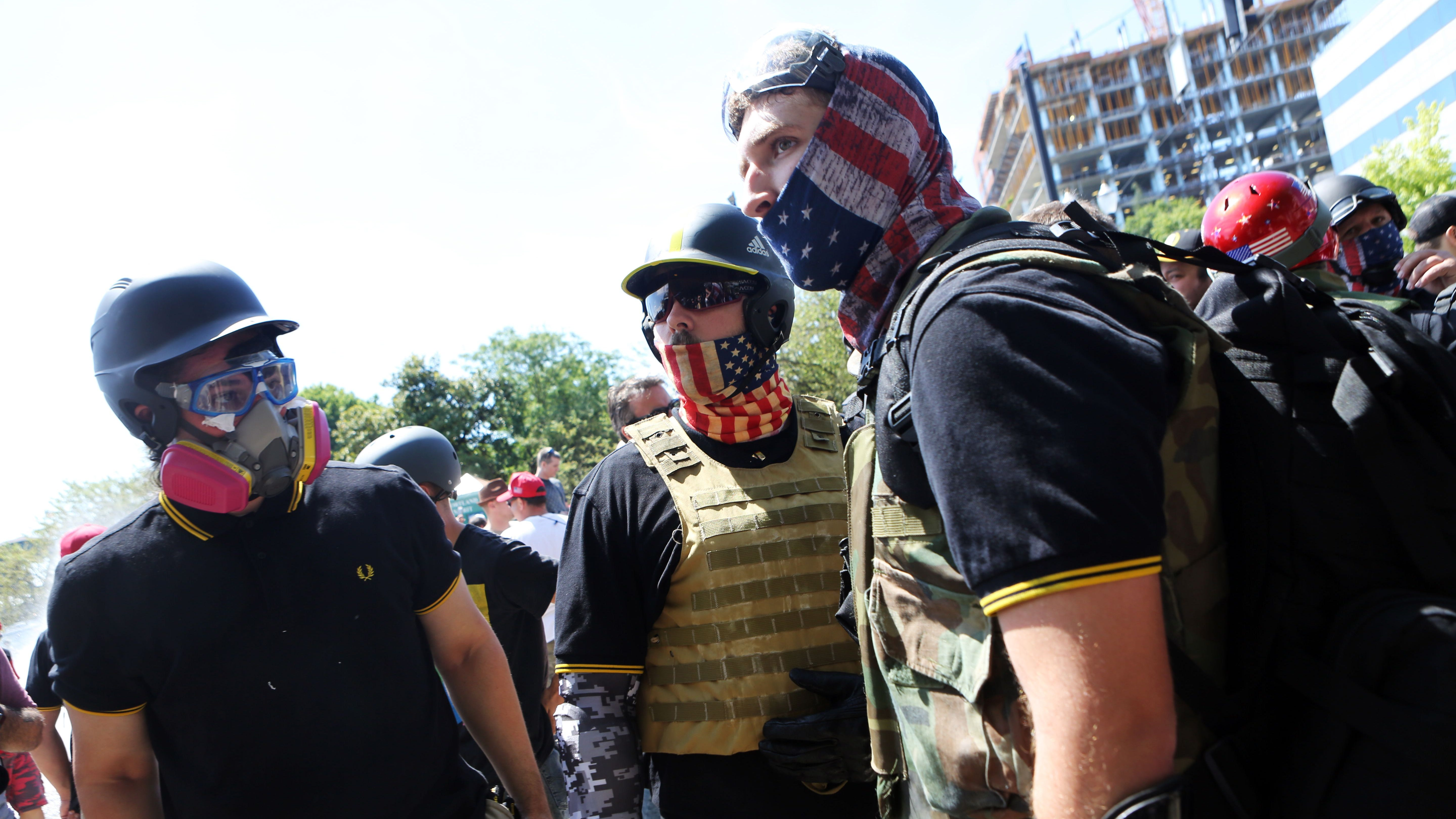 """Opposing Alt-right activists, anti-fascist protestors, and people on all sides of the political spectrum gather for a campaign rally organized by right-wing organizer, Patriot Prayer founder and Republican Senate candidate Joey Gibson in Portland, Oregon, August 4, 2018. Police in Portland braced for violence at the rally that has raised fears of a replay of last year's deadly """"Unite the Right"""" protests in Charlottesville, Virginia. Patriot Prayer and the Proud Boys, right-wing groups linked to violence at a previous Portland rally, planned to march in the city's Tom McCall Waterfront Park in support of Patriot Prayer founder Joey Gibson, who is running as a Republican for the US Senate. Meanwhile, a group called Popular Mobilization is organizing a counter-demonstration at the park, accompanied by a marching band and protesters in clown costumes. / AFP PHOTO / Thomas PattersonTHOMAS PATTERSON/AFP/Getty Images ORG XMIT: Fears of ORIG FILE ID: AFP_1850X2"""