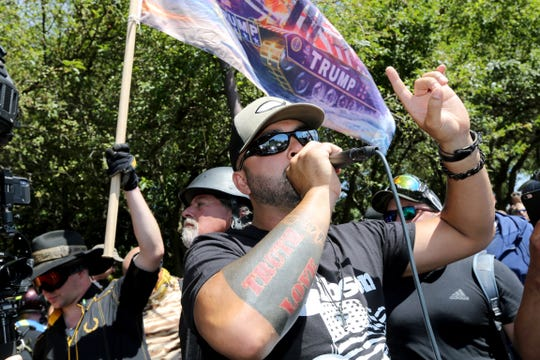 Organizer Joey Gibson and right-wing demonstrators rally on Aug. 4 in Portland, Ore.