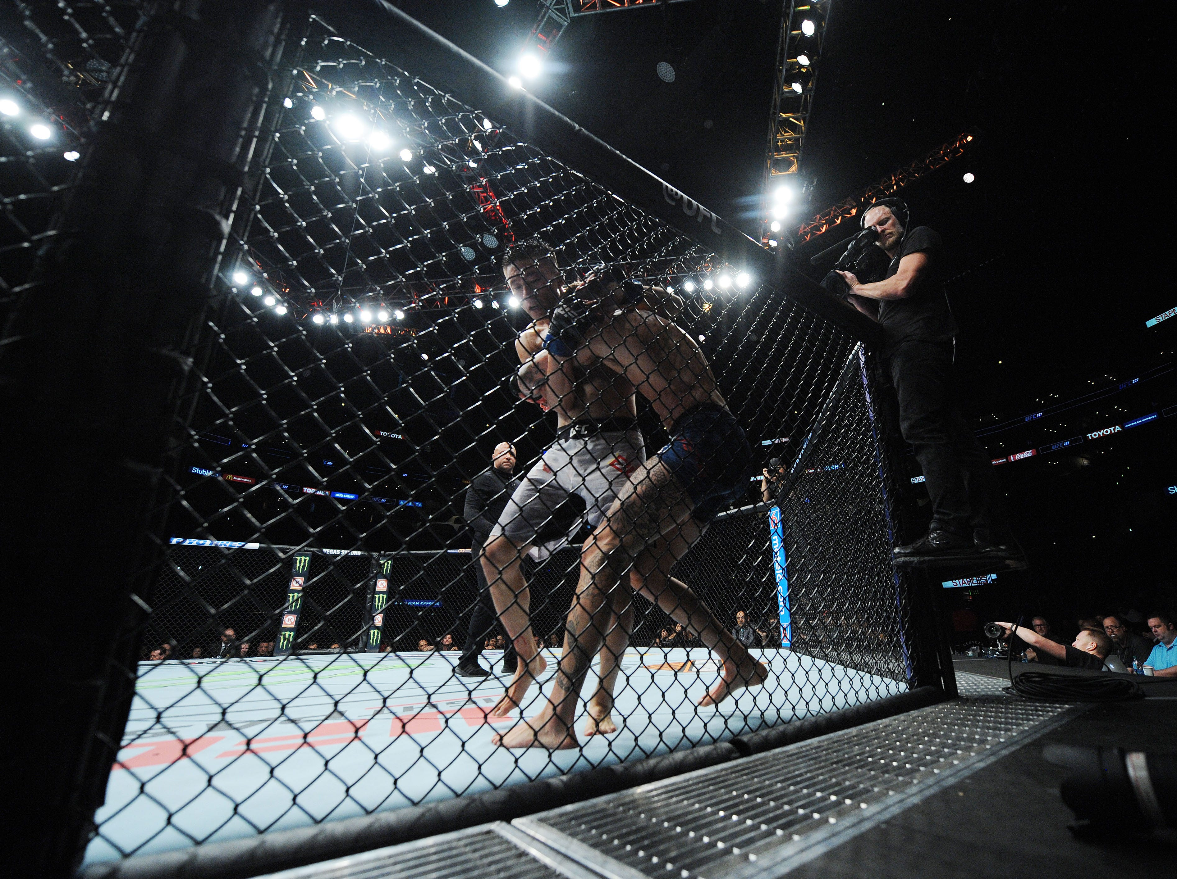 Wuliji Buren pins Marlon Vera to the cage during UFC 227 at Staples Center.