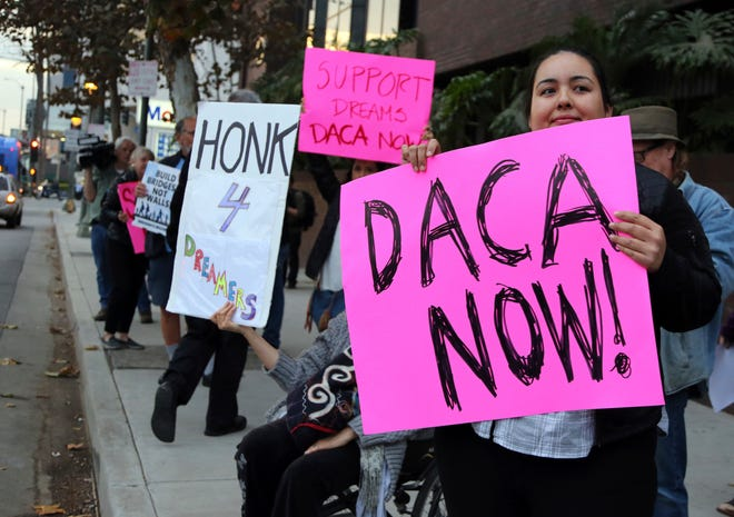 Demonstrators urging the Democratic Party to protect the Deferred Action for Childhood Arrivals Act (DACA) rally outside the office of California Democratic Sen. Dianne Feinstein in Los Angeles.