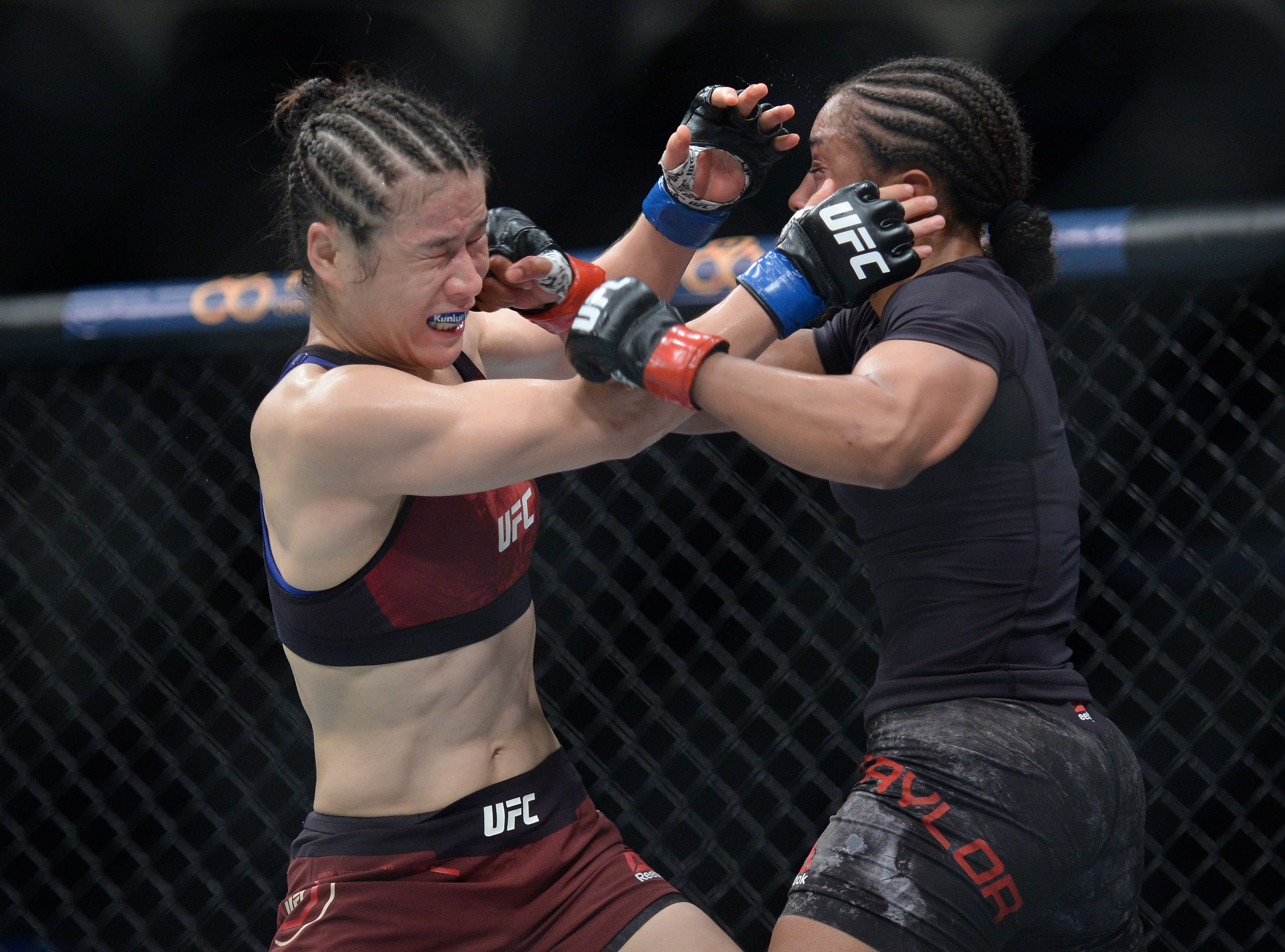 Weili Zhang defends against Danielle Taylor during UFC 227 at Staples Center.