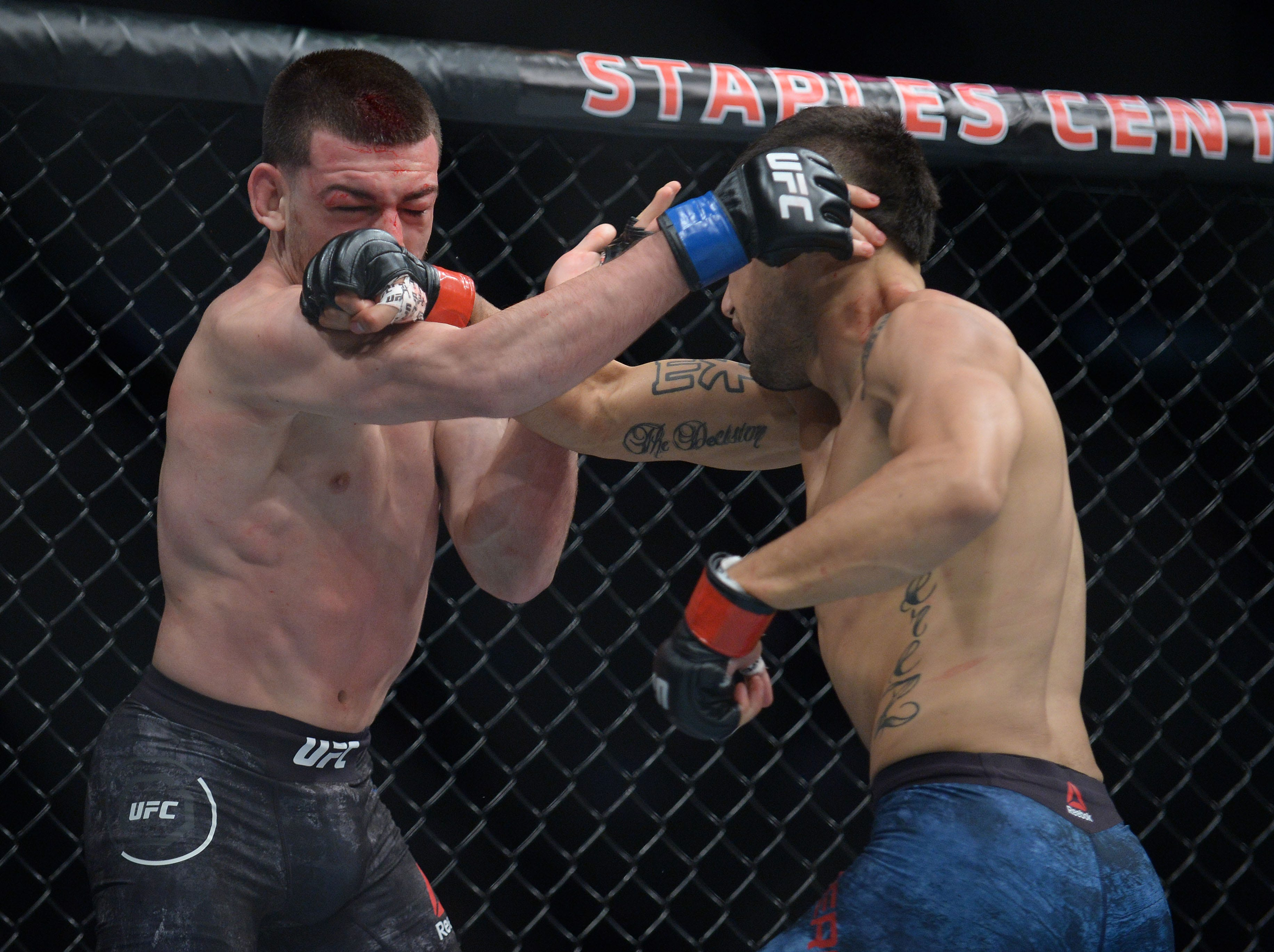 Alex Perez lands a hit as Jose Torres defends during UFC 227 at Staples Center.