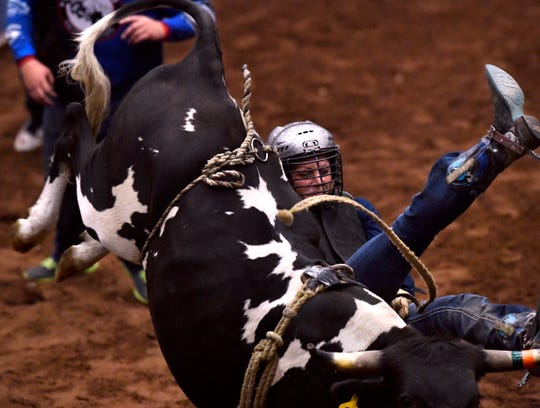 Australian Nikki Leather gets bucked from her steer during Moms' Steer Riding July 31, 2018 at the Taylor County Coliseum.