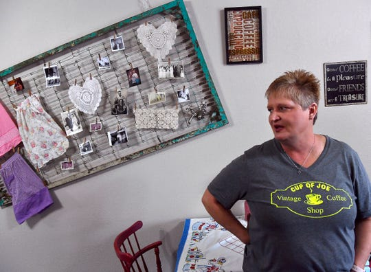 Melinda Meyers, the owner of Cup of Joe Vintage Coffee Shop in Winters, talks about the decor in the shop's dining room. Hanging from the old bed springs behind her are family photographs depicting her parents, grandparents and inlaws.