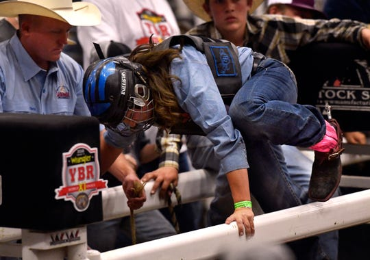 Lisa Hughes of Anahuac climbs into the chute during Moms' Steer Riding, which kicked off the 11th annual Youth Bull Riders World Finals.