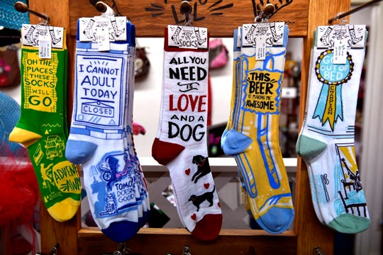 Colorful socks hang on display in the Vintage Shops, part of Cup of Joe Vintage Coffee Shop in Winters. The mini-mall features an eclectic range of goods.