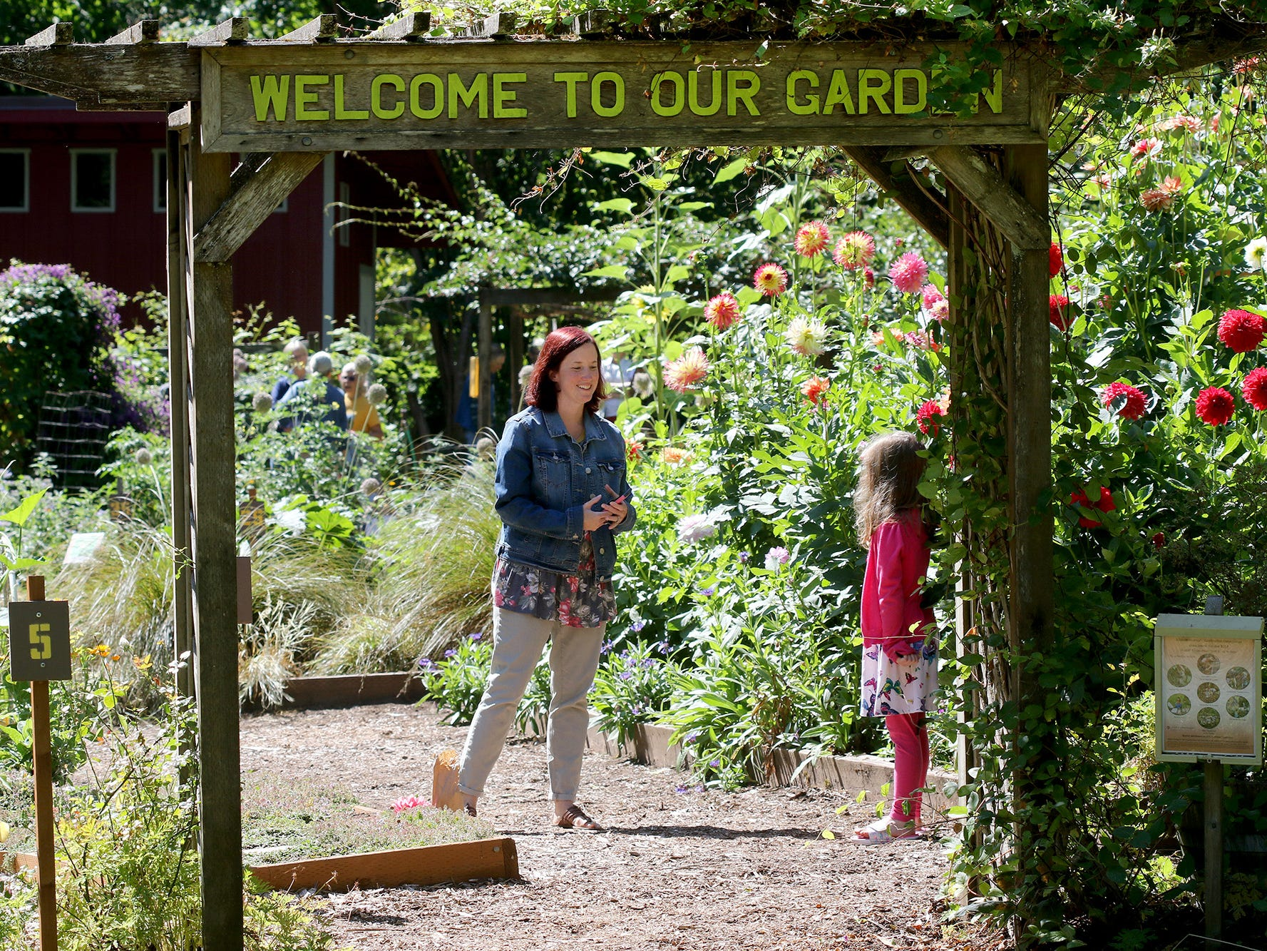 Esther Deal, of Bremerton, and her daughter Kara, 5, at the entrance to the Anna Smith Garden on Saturday, August 4, 2018.