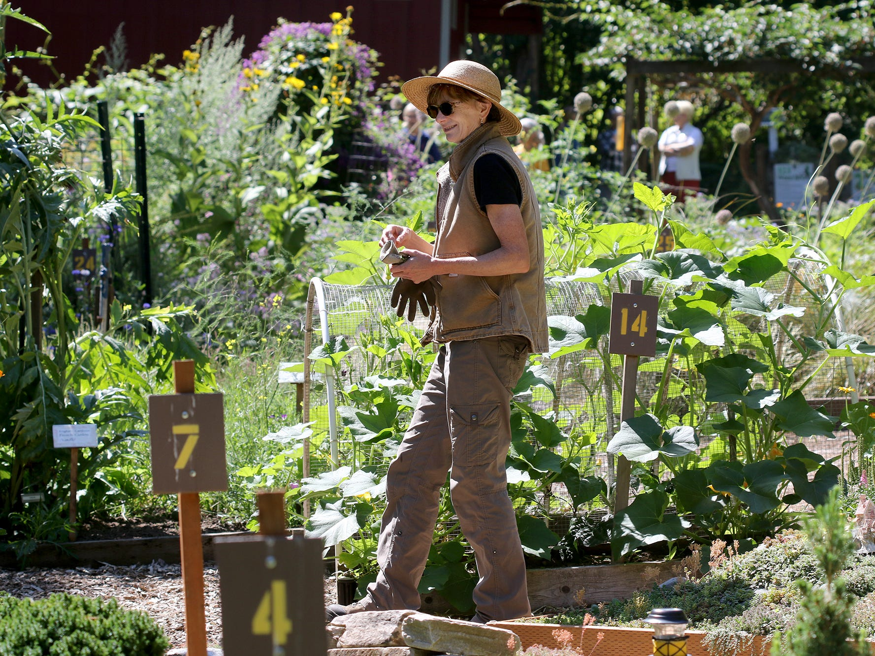 Linda Treflinger, of the WSU Master Gardener Program, works in the garden at the Anna Smith Garden.