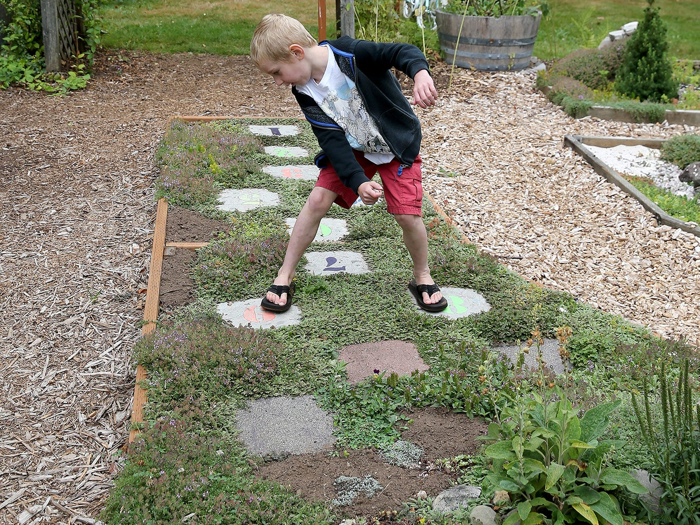 Keegan Lockwood, 6, plays hop scotch at Anna Smith Garden.