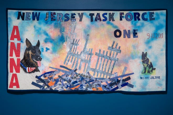 """A memorial quilt depicting Anna, a German shepherd who responded to the attack on the World Trade Center, is part of the """"Dogs of 9/11"""" exhibit at the 9/11 Memorial Museum. The quilt was created by Sue Sanders of Runnemede, who knew Anna from her visits to a South Jersey senior center."""