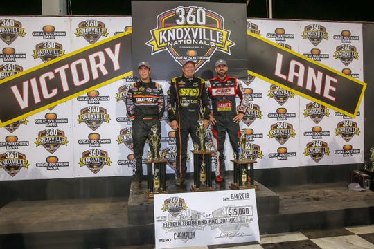 Altoona's Terry McCarl, center, capture his fifth career A-main title in the 360 cubic-inch-engine Knoxville Nationals on Saturday, Aug. 4, 2018. Carson Macedo of Lemoore, California, and Brian Brown Grain Valley, Missouri, who flank McCarl, finished second and third, respectively.