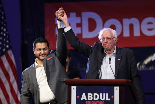 Michigan Democratic gubernatorial candidate Dr. Abdul El-Sayed, left, and Sen. Bernie Sanders raise their arms after addressing supporters during a rally for El-Sayed, Sunday, Aug. 5, 2018, in Detroit.