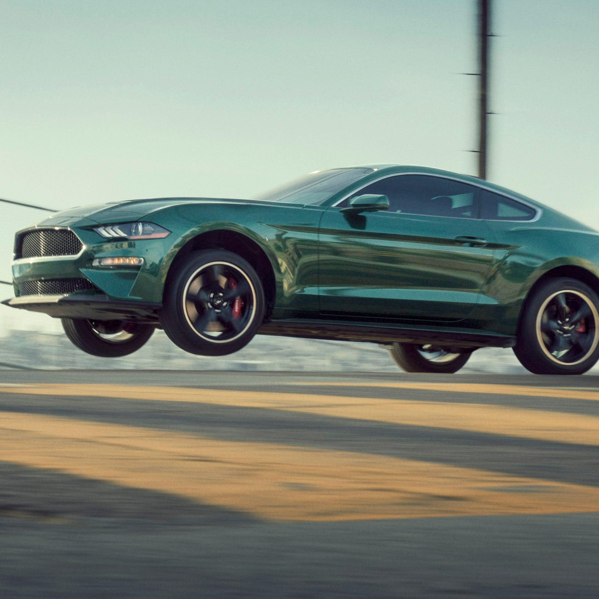 The 2019 Ford Mustang Bullitt goes airborne on the streets of San Francisco.