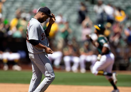 Detroit Tigers starting pitcher Francisco Liriano waits while Oakland Athletics designated hitter Khris Davis runs out his solo home run during the fourth inning Sunday, Aug. 5, 2018, in Oakland.