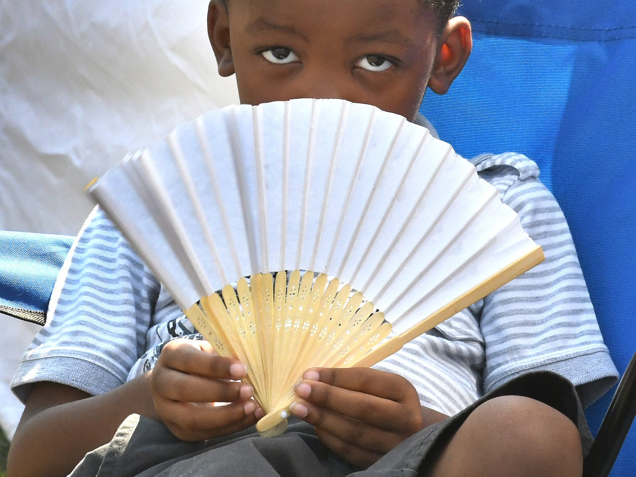 Playing it cool and staying cool at the same time, Miles Campbell, 6 deals with the 90 plus temperatures at the Belle Isle Art Fair.