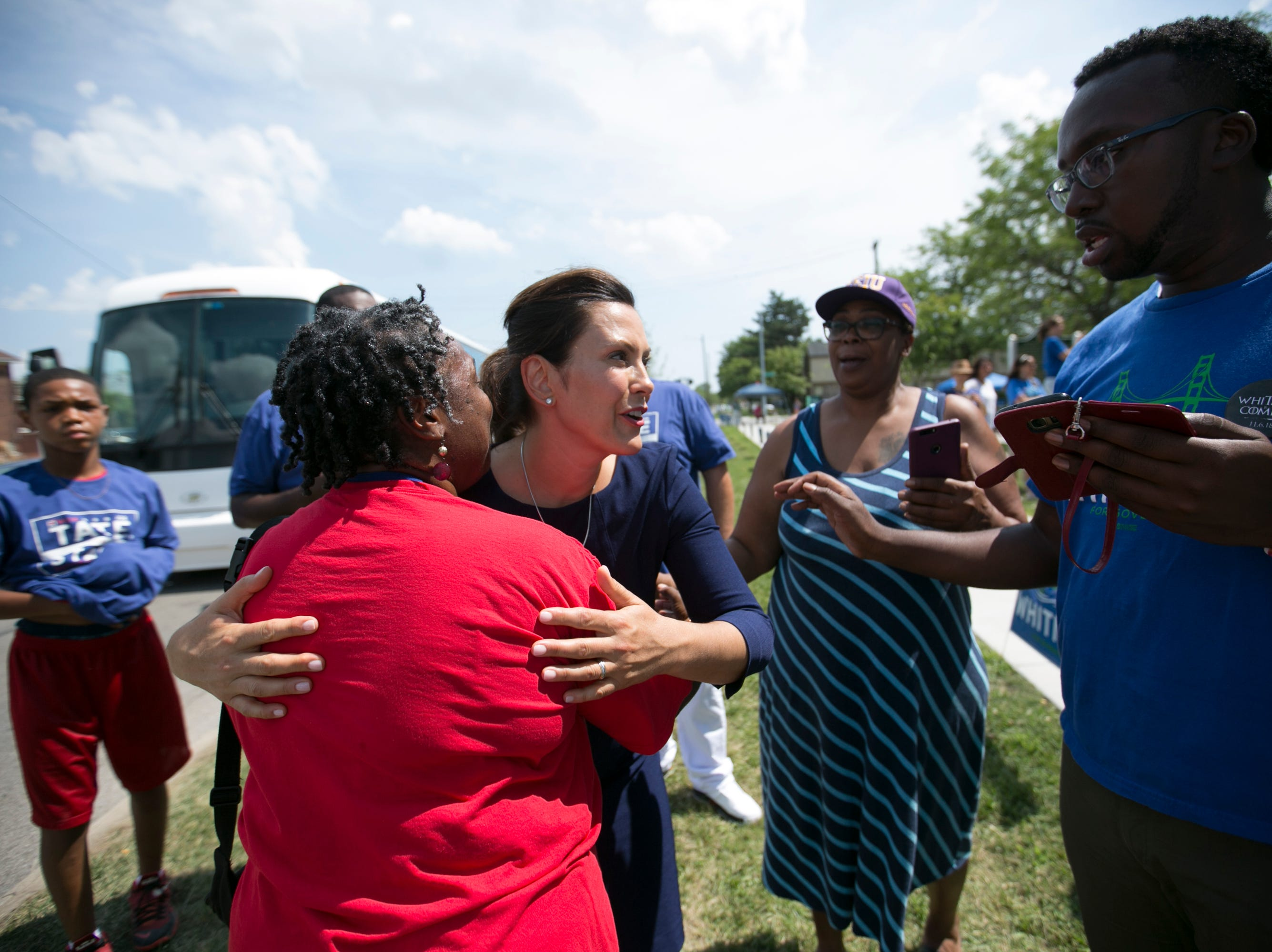 Gubernatorial candidate Gretchen Whitmer works the crowd at Gordon Park in Detroit on August 5, 2018.