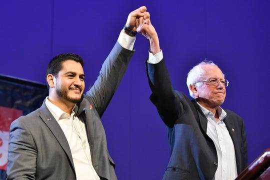 Abdul El-Sayed and U.S. Sen. Bernie Sanders together at the end of Sanders' speech at Cobo Center in Detroit in 2018.