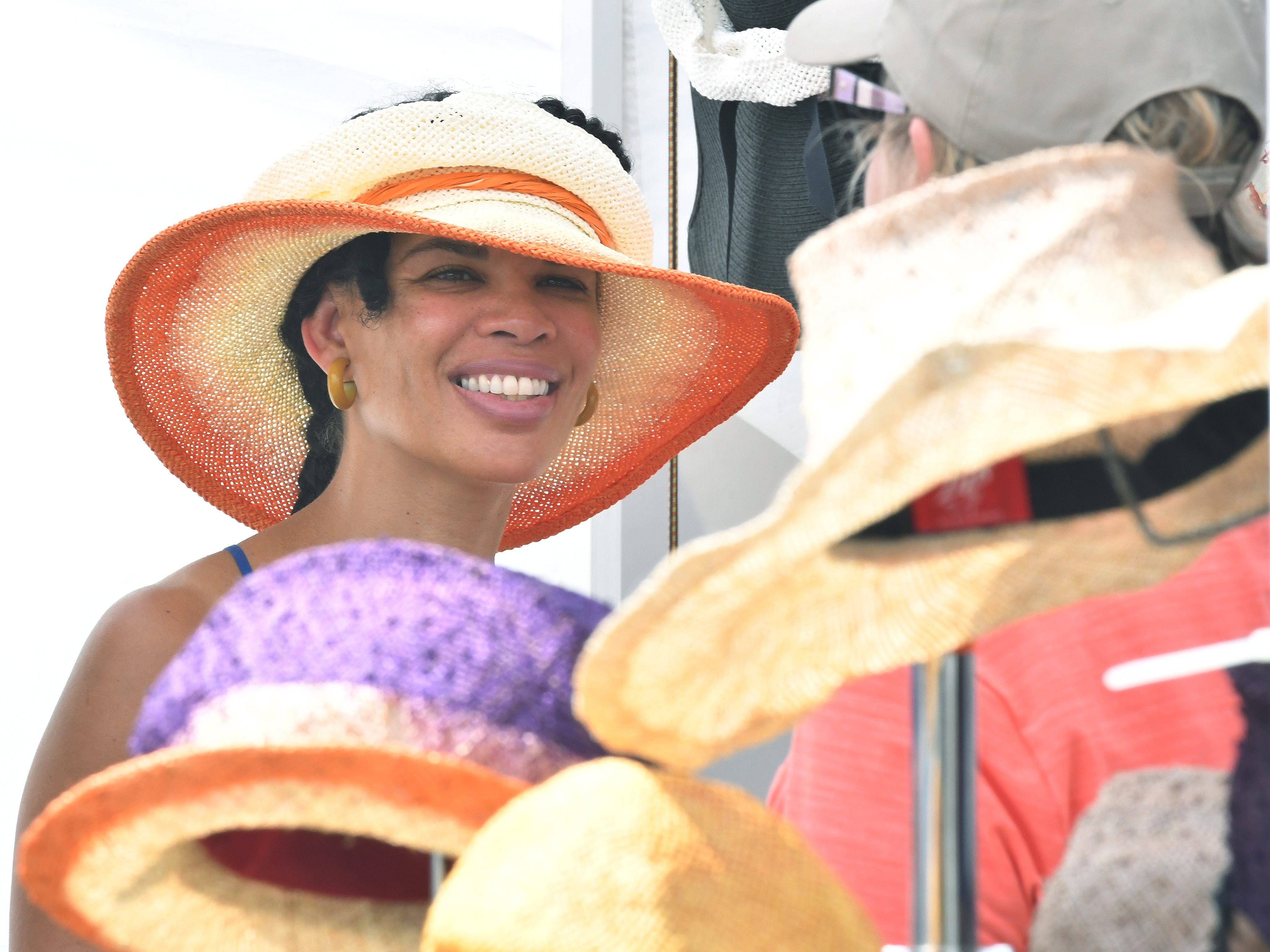 Ella Isaac of L.I.P.S. Hats (Living In Perfect Style) at her booth at the Belle Isle Art Fair.
