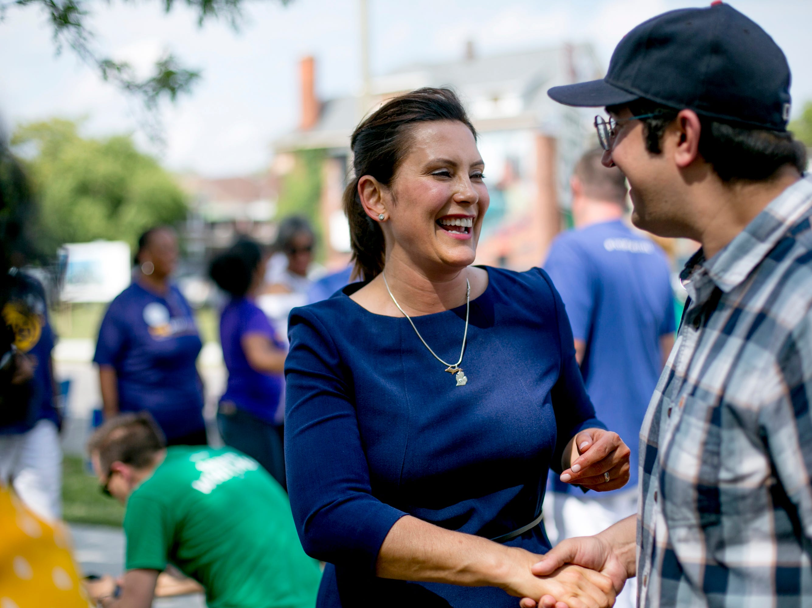 Gubernatorial candidate Gretchen Whitmer greets supporters during a campaign event at Gordon Park.
