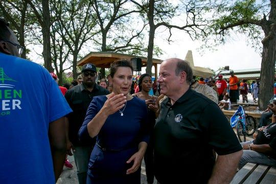 Gubernatorial candidate Gretchen Whitmer talks to Detroit Mayor Mike Duggan at a campaign event at Gordon Park.