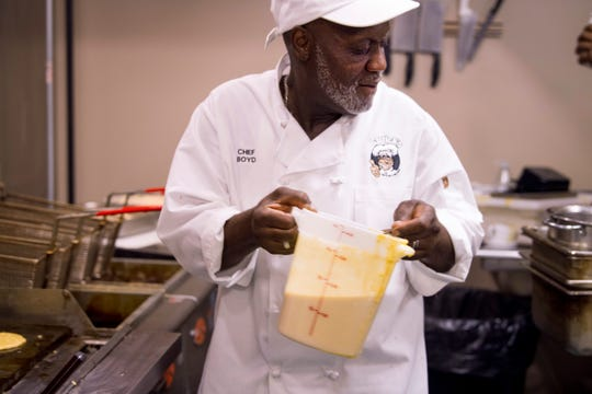 "Gary ""Gatrick"" Boyd begins the process of frying corn cakes at Gatrick's Bar-B-Que and Fine Dishes Sunday morning. ""I make my corn cakes like pancakes,"" Boyd said."