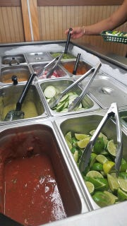 Fix your plate the way you like it with El Paisano's salsa bar. Offerings range from mild to yowza.