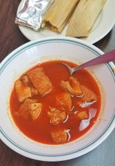 Menudo is a favorite Mexican dish of beef tripe simmered in a spiced broth. Here is El Paisano's version, served with two hand-made pork tamales.