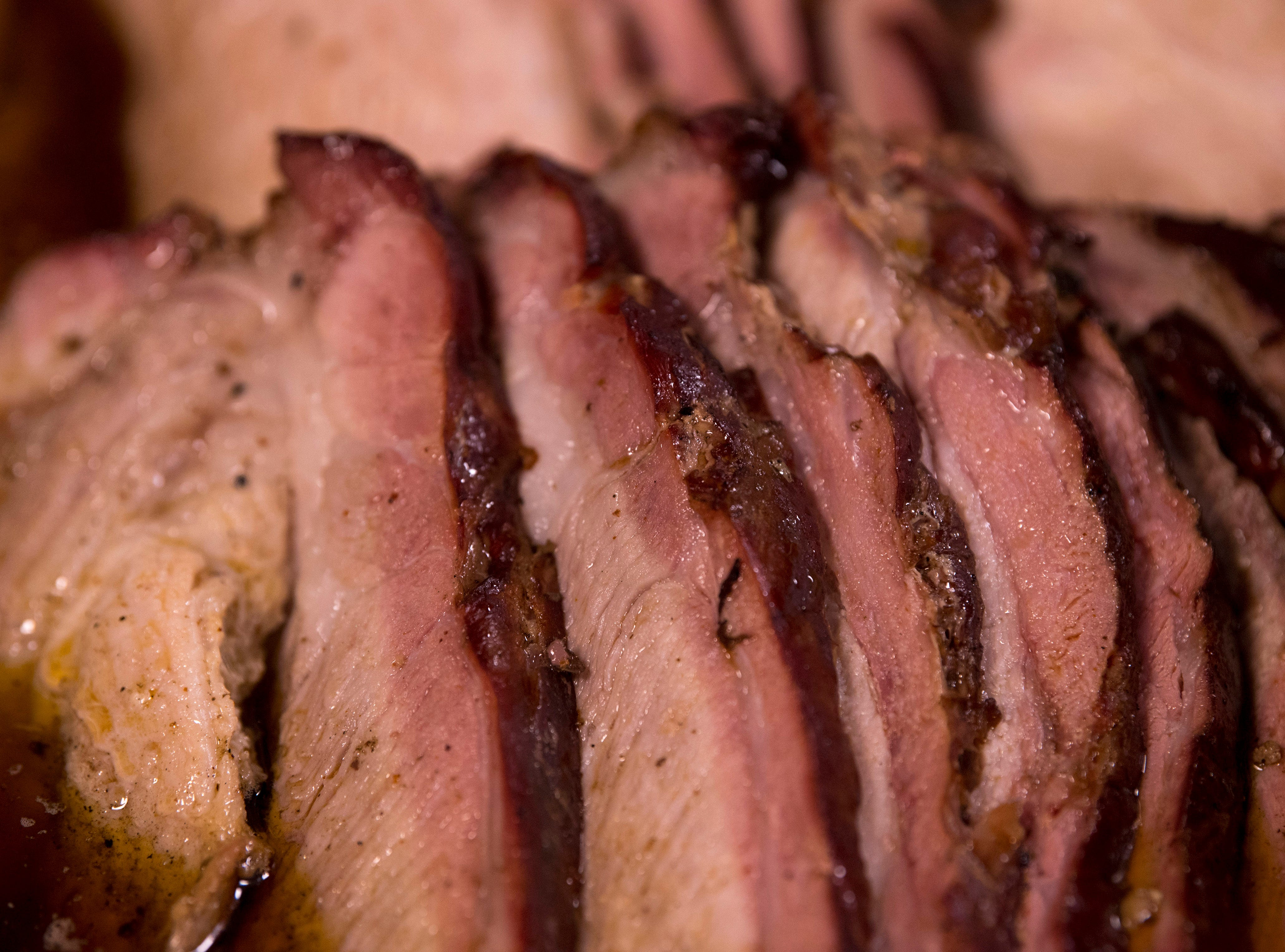 Smoked pork butt slices show off nearly a one-inch wide smoke ring at Gatrick's Bar-B-Que and Fine Dishes Sunday morning. The special, and there's always a special at Gatrick's, was pork butts, greens, macaroni and cheese, dressing and corn cakes.