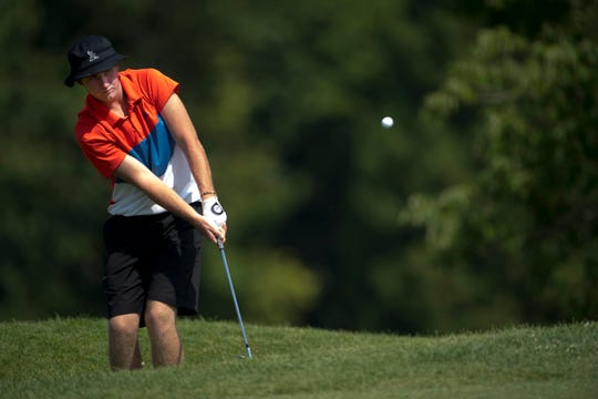 Stewie Hobgood chips onto the 4th green during the Courier & Press Men's City Tournament at John H. Fendrich Golf Course.