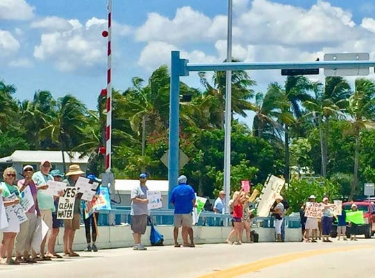 Protesters on the Matlacha Bridge decry water issues in Southwest Florida