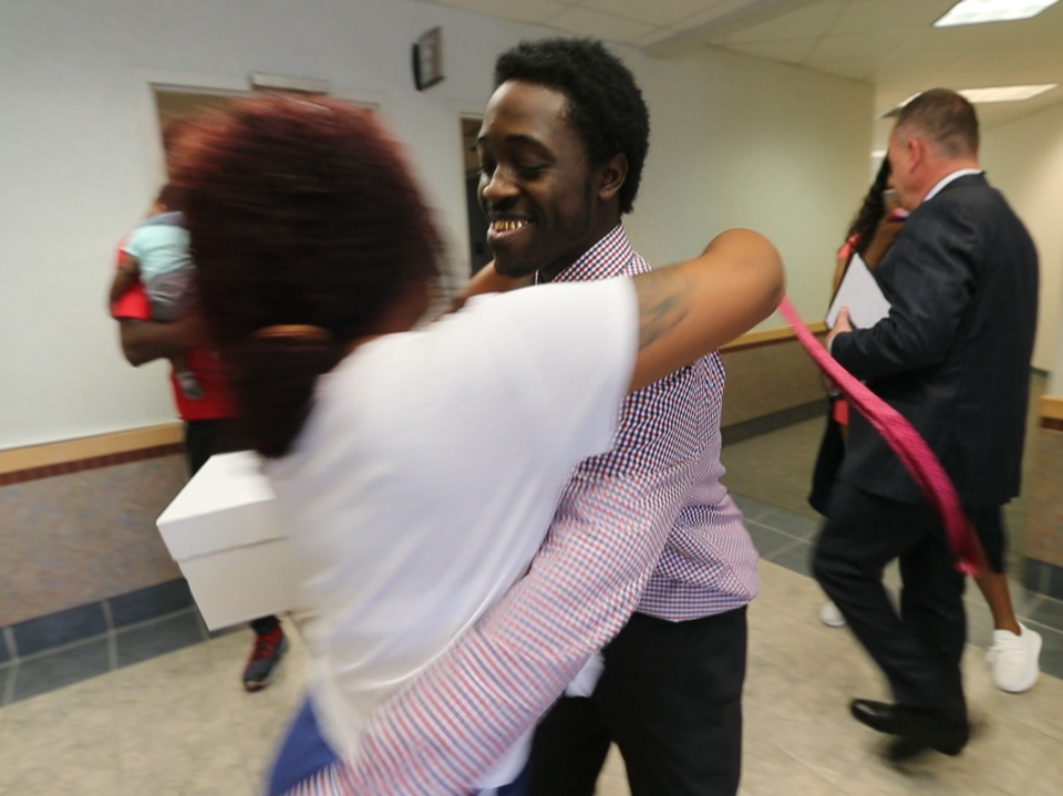 James Brown gets a hug after being found not guilty of being a member of a gang Saturday by a Lee County jury.