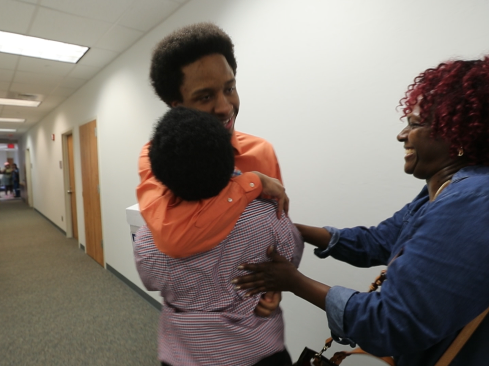 Diante Davis and James Brown hug  after being found not guilty of being members of a gang Saturday by a Lee County jury.