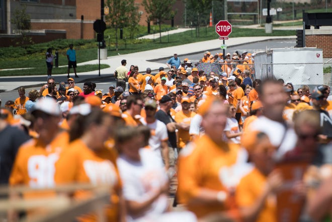 Fans wait to enter the stadium outside of Neyland at University of Tennessee before fan day Sunday Aug. 5, 2018.
