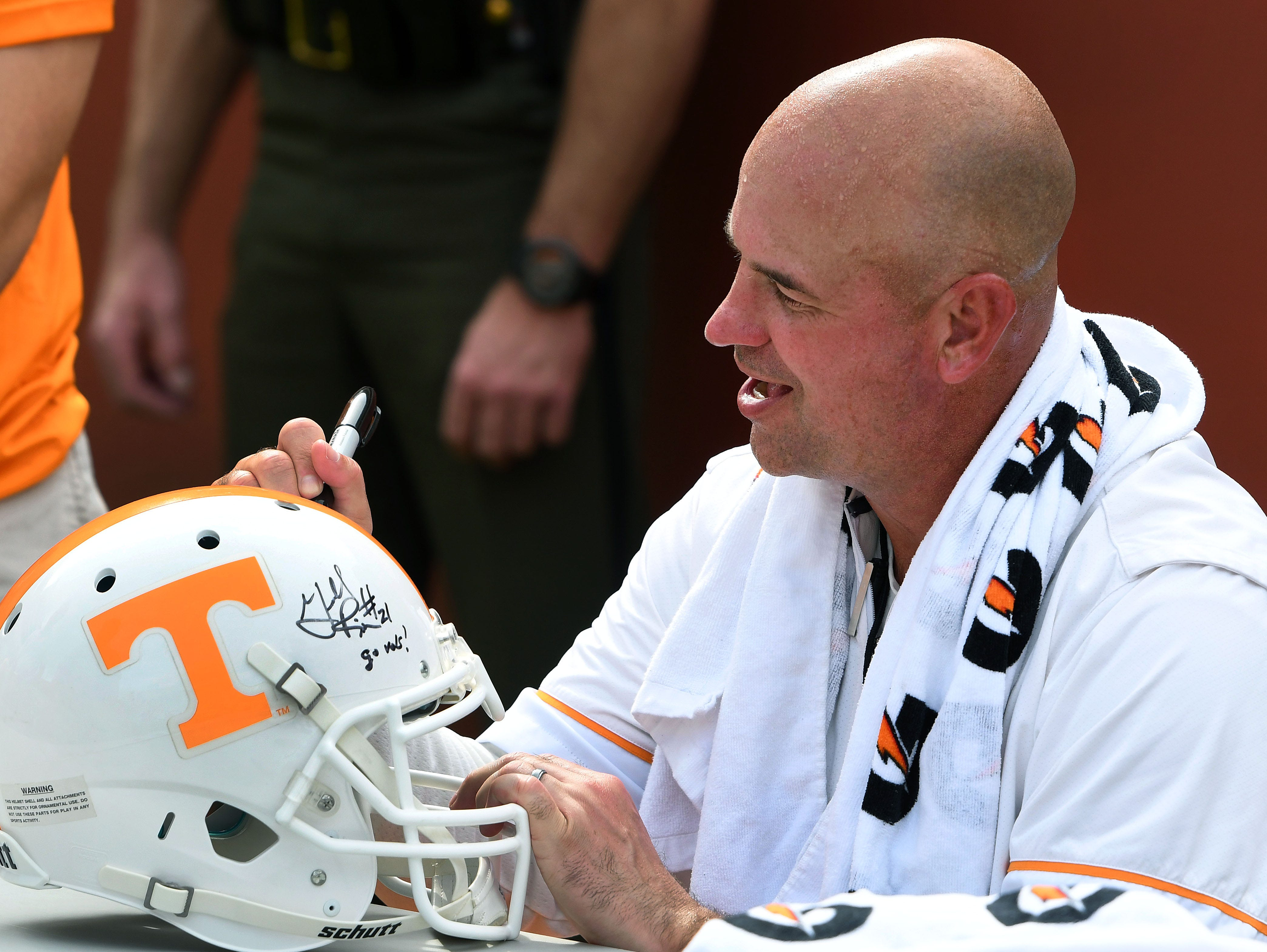 Tennessee Head Coach Jeremy Pruitt signs autographs for fans at the conclusion of practice as part of Fan Day in Neyland Stadium Sunday, August 5, 2018.